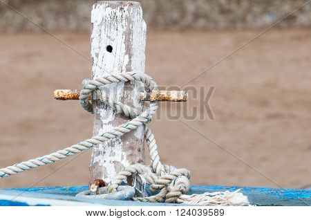 Mast of a fishing boat with a rope tied to it