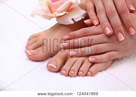pedicure on legs and beautiful manicure on hands closeup.