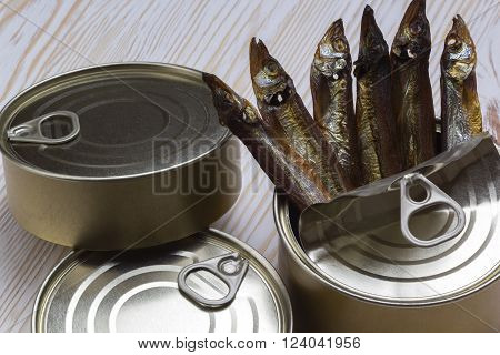 Close-up of Tinned capelin fish on light wooden background