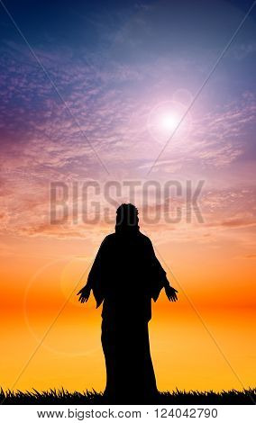 an illustration of Jesus silhouette at sunset
