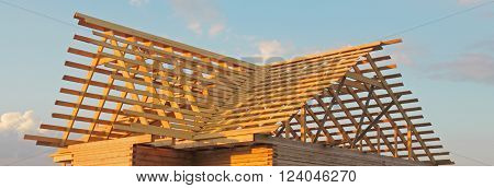 Timber house under constructoin - roof frame photo