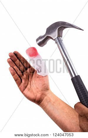 Isolated dirty hand with injured finger is holding a hammer