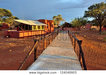 SOSSUSVLEI NAMIBIA - JAN 30 2016: Accommodation units in the Sossusvlei Lodge at bright sunset light the most popular place in Namib-Naukluft national park to stay and relax during safari