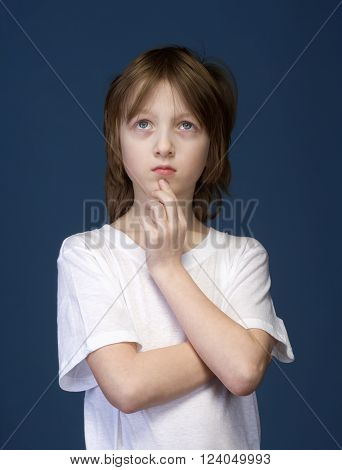 Portrait of a Boy with Blond Hair Thinking