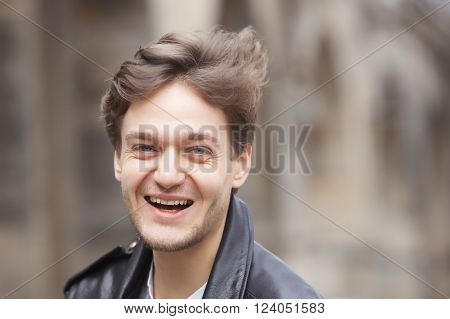 Portrait of a Young Man with Brown Hair Outdoors. ** Note: Soft Focus at 100%, best at smaller sizes