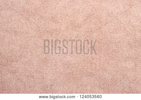 Macro bright beige suede soft leather as texture background
