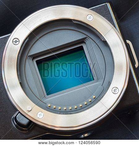 Digital camera sensor. APS-C CMOS sensor on a digital mirrorless camera.