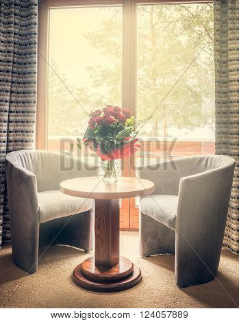 Romantic scene of red roses bouquet on a table