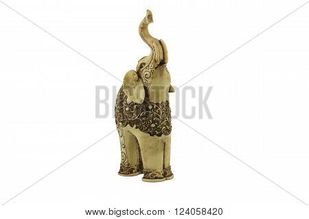 Carved statuette of indian elephant  with beautiful ornate pattern. Made of the ivory in Sri Lanka. Isolated on white. Front view of statuette.