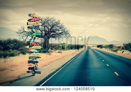 Funny directions signpost with distance to many different countries