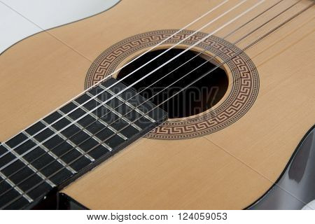 Closeup of strings of a classical acoustic guitar (selective focus on the strings)