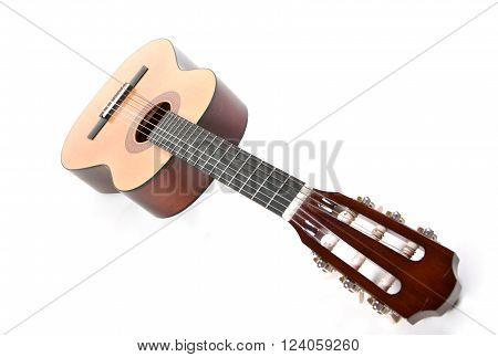 Closeup of an old classical acoustic guitar (shallow DOF, selective focus on the strings) with copy space for your text