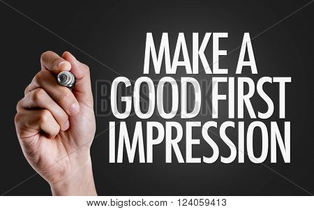Hand writing the text: Make a Good First Impression