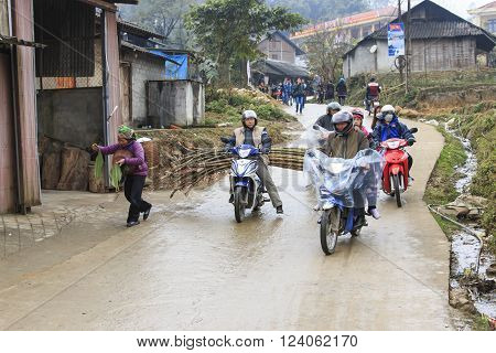 Sapa Vietnam - February 16 2016: People in the main street of Sapa village in north Vietnam