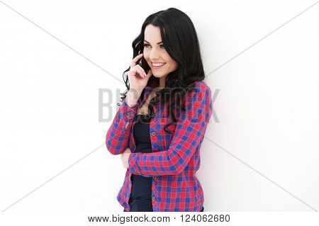 Girl In Checkered Shirt  Speaking On Cellphone.