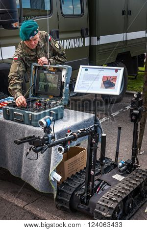 WARSAW, POLAND - MAY 08, 2015: Sapper at the control board of tracked Robot TALON. 70th anniversary of End of WW II