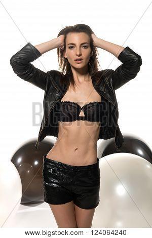 Beautiful slim Italian woman dressed in black leather