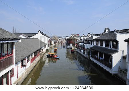 Shanghai, China.  February 8, 2016.  Chinese visitors during Spring Festival on tourist boats on the water canals of Zhaojialou town on a sunny day in Shanghai China.