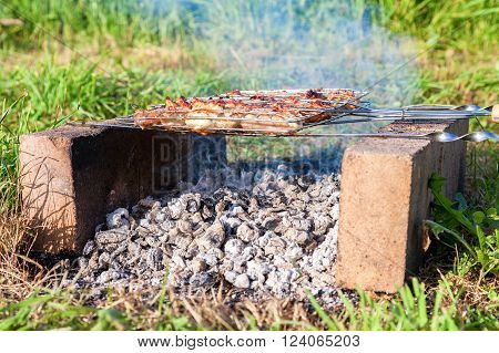 Barbecue with delicious grilled meat on the improvised oven made of brick