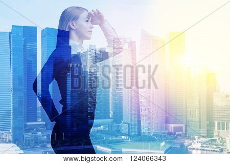Businesswoman with hand at forehead office buildings. Double exposure. Concept of work.