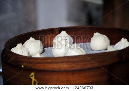Xiaolongbao or chinese soup dumplings waiting to be steamed in a bamboo steamer in Nanxiang Town in Shanghai China.