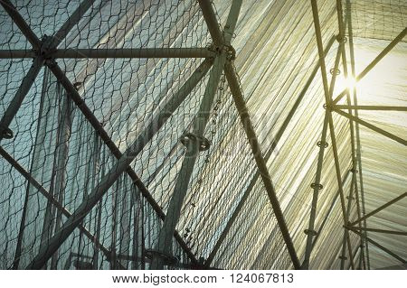 Scaffold structure with a security net at sunset time.