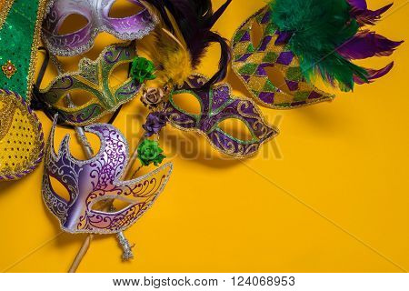 A venetian mardi gras mask or disguise on a yellow background