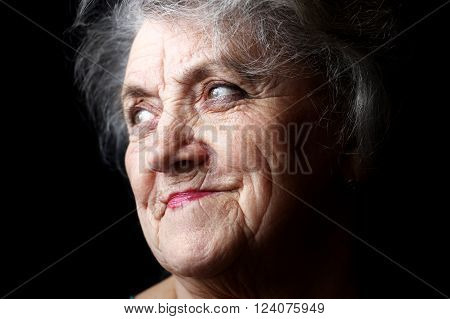 Thougtful granny face on a black background