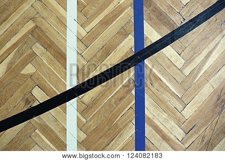 Worn Out Wooden Floor Of Sports Hall With Colorful Marking Lines.