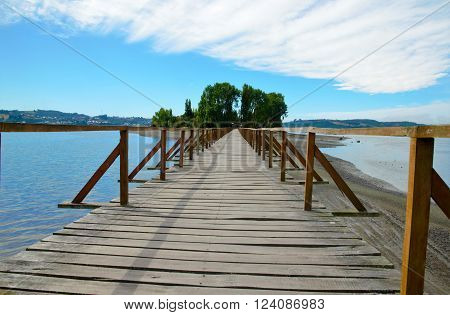 A long wooden bridge leads to the small island Aucar close to Quemchi on the island Chiloé in Chile