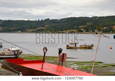 CASTRO, CHILE - MARCH 13, 2016: Close-up of Boats in the water during low tide on March, 13, 2016 in Castro, Chile