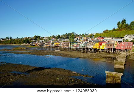 Long shot of traditional stilt houses in Castro on the island Chiloé in Chile during low tide