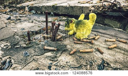 After the war.Old toy and ammunition in the wreckage of the building
