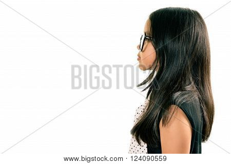 Studio Portrait Of Little Girl With Serious Face In Profile