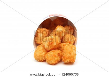 Tater tots in a containter on a white background