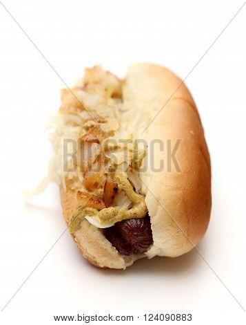 A fresh hotdog on a white background