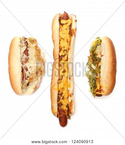 Three different kinds of hotdogs on a white background