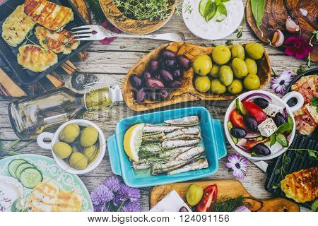 Greek cuisine dishes - feta, choriatiki, halloumi, tzatziki, sardines (filtered)