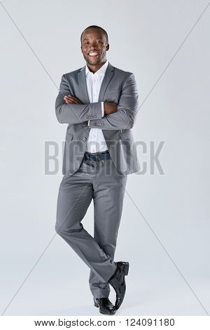 Full length portrait of positive smiling black  professional in business suit isolated in studio