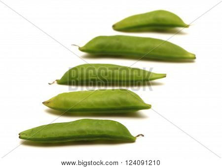 Fresh green snap peas on a white background