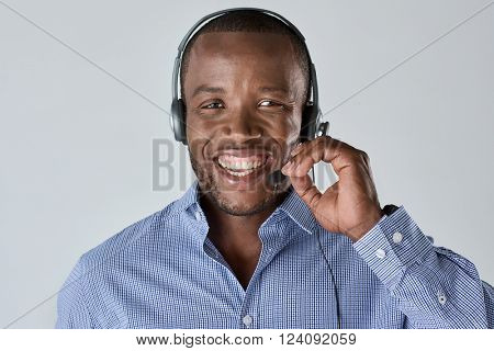 African man operator salesman telemarketer smiling with microphone headset