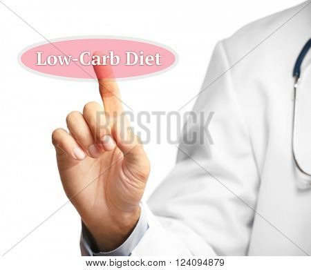 Doctor pointing on Low-Carb Diet button isolated on white