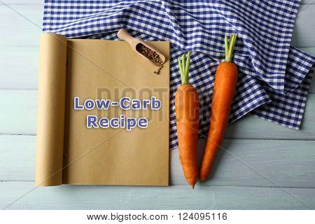 Text Low-Carb Recipe in recipe book on wooden background
