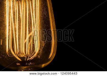 Vintage Edison Light Bulbs hanging against a black  background