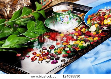 colorful candy fruit drops with gems scattered on a tray Tea Party celebration New Year Christmas