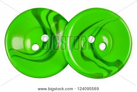 Green Plastic buttons isolated on white background