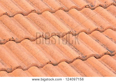 Closeup of the red roof tiles with stains