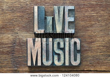 live music phrase made from wooden letterpress type on grunge wood