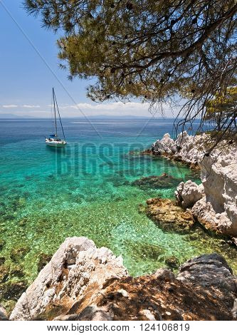 Landscape with yacht rocks and clear Aegean Sea water Skopelos island