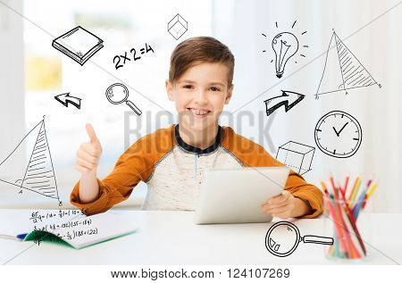 leisure, children, technology, education and people concept - smiling boy with tablet pc computer and notebook showing thumbs up at home over mathematical doodles
